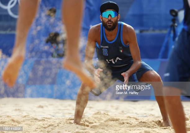 Daniele Lupo of Team Italy competes against Team Poland during the Men's Preliminary - Pool F beach volleyball on day seven of the Tokyo 2020 Olympic...