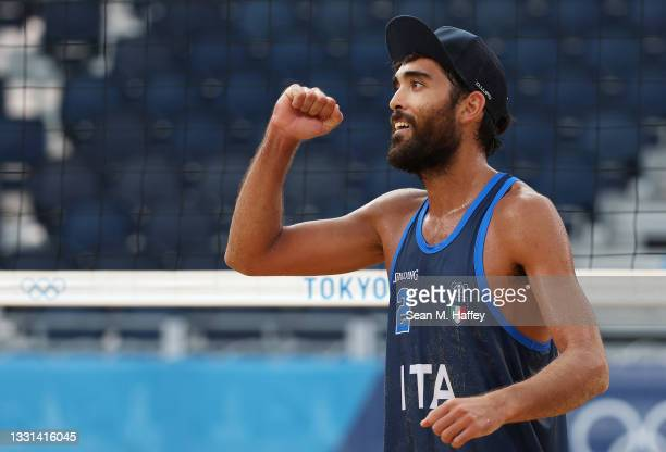 Daniele Lupo of Team Italy reacts after defeating Team Poland during the Men's Preliminary - Pool F beach volleyball on day seven of the Tokyo 2020...