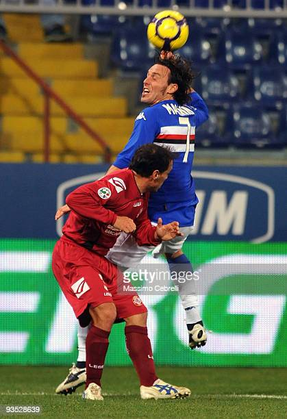 Daniele Mannini of UC Sampdoria and Antonio Filippini of AS Livorno jump for a header during the TIM Cup match between UC Sampdoria and AS Livorno at...