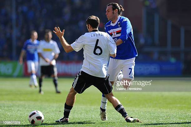 Daniele Mannini of UC Sampdoria clashes with Maurizio Lauro of AC Cesena during the Serie A match between UC Sampdoria and AC Cesena at Stadio Luigi...