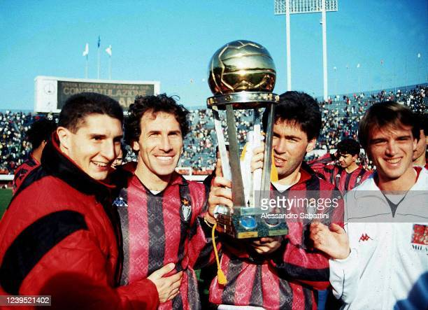 Daniele Massaro, Franco Baresi, Carlo Ancelotti and Stefano Carobbi celebrate the victory with the trophy after winnig the 1998 Intercontinental Cup...