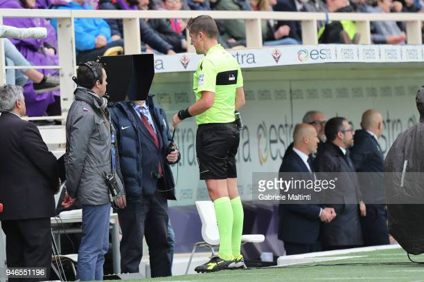 Daniele Orsato referee consults the VAR during the serie A match between ACF Fiorentina and Spal at Stadio Artemio Franchi on April 15 2018 in...