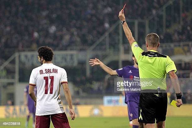 Daniele Orsato referee shows the red card to Mohamed Salah of AS Roma during the Serie A match between ACF Fiorentina and AS Roma at Stadio Artemio...