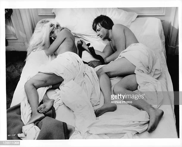 Daniele Ouimet and John Karlen lay in bed in a scene from the film 'Daughters Of Darkness' 1971