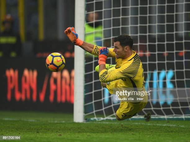 Daniele Padelli of FC Internazionale victory jumps to save a penalty kick by Pordenone player during the TIM Cup match between FC Internazionale and...