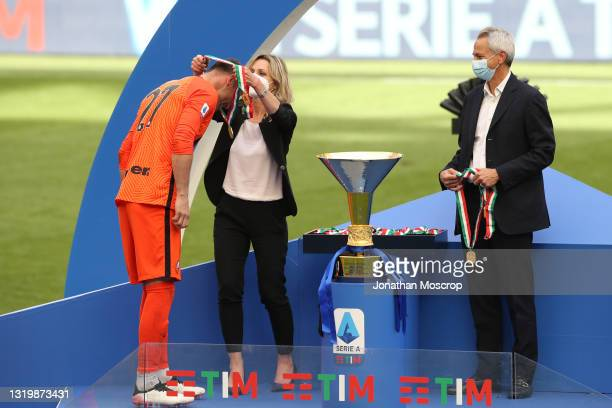 Daniele Padelli of Internazionale receives his winners' medal from Valentina Vezzali as Paolo Dal Pino looks on during the trophy ceremony following...