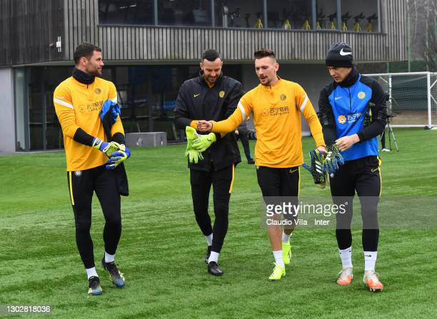 Daniele Padelli, Samir Handanovic, Ionut Andrei Radu and Filip Stankovic chat during a training session at Appiano Gentile on February 18, 2021 in...