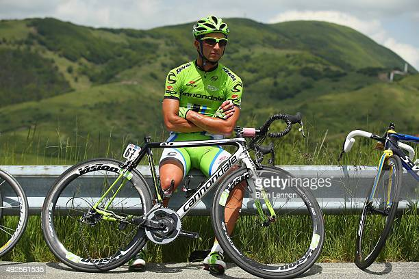 Daniele Ratto of Italy and Cannondale waits assistance with his broken bike after a crash during the eleventh stage of the 2014 Giro d'Italia a 249km...