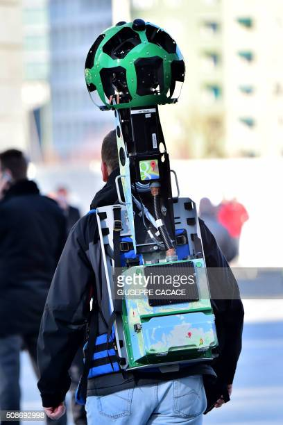 Daniele Rizzetto computer engineer walks carrying a Street View trekker backpack with a 360° camera system on top on February 5 2016 in central Milan...