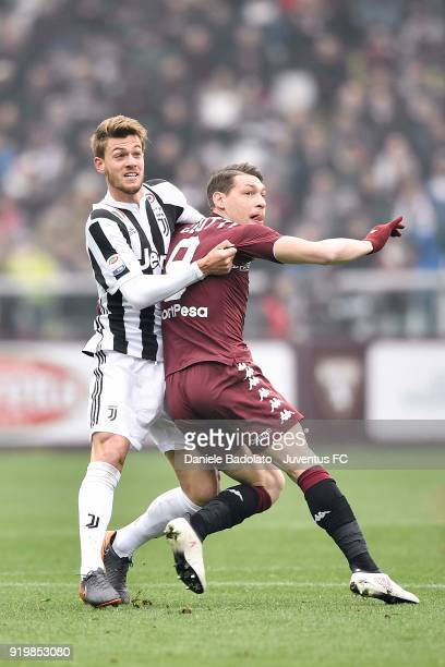 Daniele Rugani and Andea Belotti during the serie A match between Torino FC and Juventus at Stadio Olimpico di Torino on February 18 2018 in Turin...