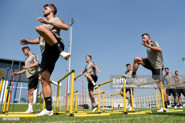 Daniele Rugani and Andrea Barzagli during a Juventus training session at Juventus Training Center on July 13 2018 in Turin Italy