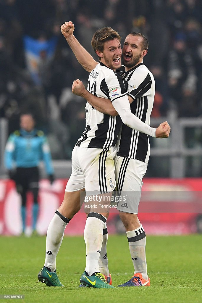 Daniele Rugani (L) and Giorgio Chiellini of Juventus FC celebrate victory at the end of the Serie A match between Juventus FC and AS Roma at Juventus Stadium on December 17, 2016 in Turin, Italy.