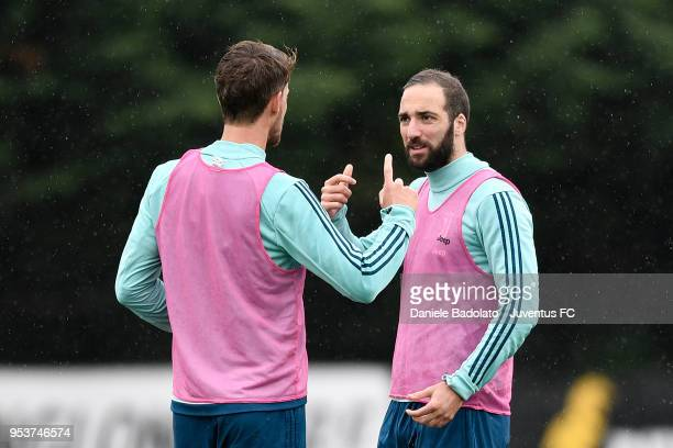 Daniele Rugani and Gonzalo Higuain during the Juventus training session at Juventus Center Vinovo on May 2 2018 in Vinovo Italy