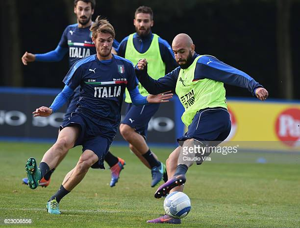 Daniele Rugani and Simone Zaza of Italy in action during a training session at Milanello on November 13 2016 in Cairate Italy
