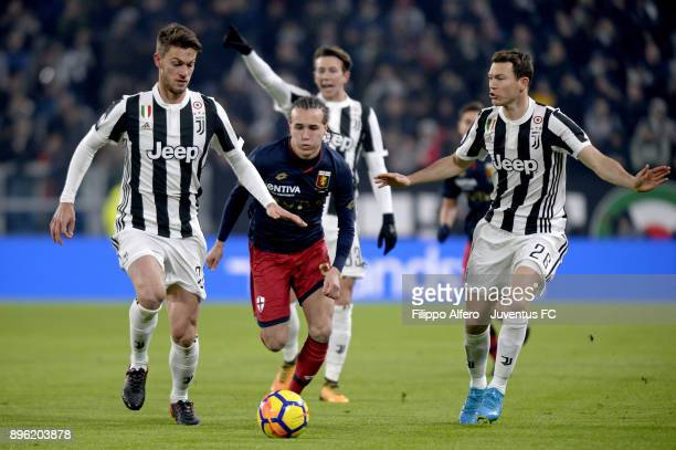 Daniele Rugani and Stephan Lichtsteiner of Juventus compete for the ball with Diego Laxalt of Genoa CFC during the TIM Cup match between Juventus and...