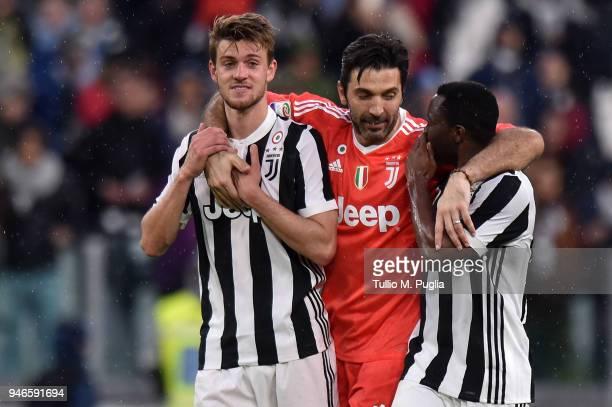 Daniele Rugani Gianluigi Buffon and Kwadwo Asamoah of Juventus celebrtate after winning the serie A match between Juventus and UC Sampdoria at...