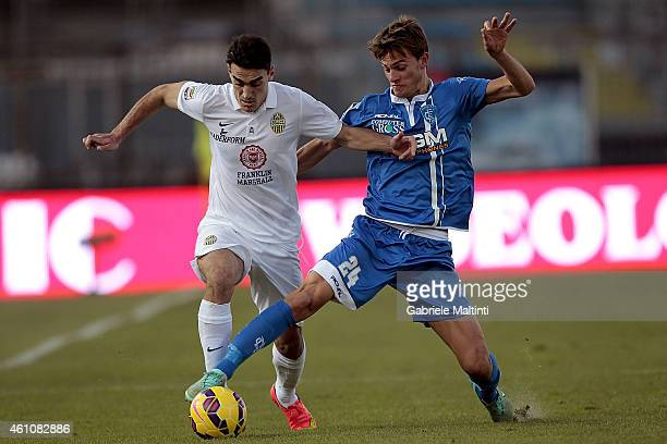 Daniele Rugani of Empoli FC battles for the ball with Gustavo Campanharo of Hellas Verona FC during the Serie A match between Empoli FC and Hellas...