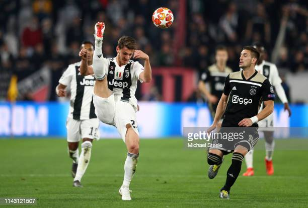 Daniele Rugani of Juventus clears the ball while under pressure from Dusan Tadic of Ajax during the UEFA Champions League Quarter Final second leg...