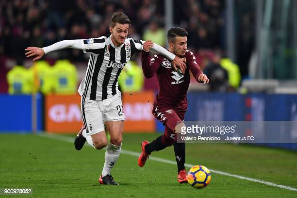 Daniele Rugani of Juventus competes for the ball during the TIM Cup match between Juventus and Torino FC at Allianz Stadium on January 3 2018 in...