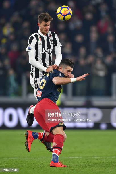 Daniele Rugani of Juventus competes for the ball with Andrej Galabinov of Genoa CFC during the TIM Cup match between Juventus and Genoa CFC at...