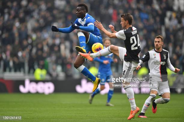 Daniele Rugani of Juventus competes for the ball with Mario Balotelli of Brescia Valcio during the Serie A match between Juventus and Brescia Calcio...