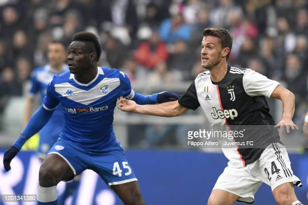 Daniele Rugani of Juventus competes for the ball with Mario Balotelli of Brescia Calcio during the Serie A match between Juventus and Brescia Calcio...