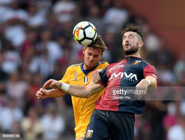 Daniele Rugani of Juventus FC and Andrey Galabinov of Genoa CFC compete for the ball during the Serie A match between Genoa CFC and Juventus at...