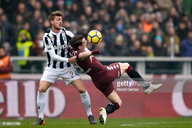 Daniele Rugani of Juventus FC competes for the ball with Andrea Belotti of Torino FC during the Serie A football match between Torino FC and Juventus...
