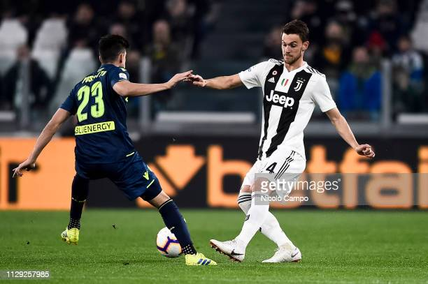 Daniele Rugani of Juventus FC competes for the ball with Ignacio Pussetto of Udinese Calcio during the Serie A football match between Juventus FC and...
