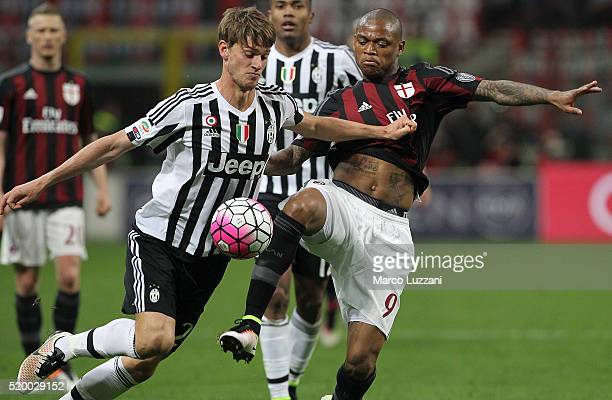 Daniele Rugani of Juventus FC competes for the ball with Luiz Adriano of AC Milan during the Serie A match between AC Milan and Juventus FC at Stadio...