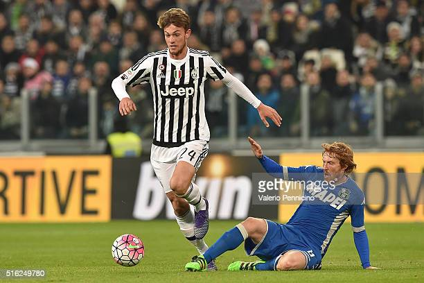 Daniele Rugani of Juventus FC is tackled by Davide Biondini of US Sassuolo Calcio during the Serie A match between Juventus FC and US Sassuolo Calcio...