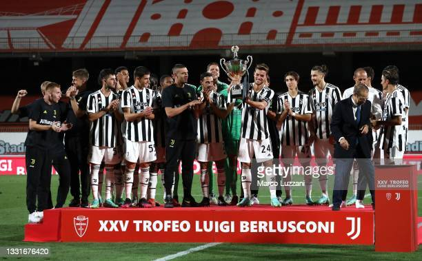 Daniele Rugani of Juventus FC lifts the Luig Berlusconi tropy during the AC Monza v Juventus FC - Trofeo Berlusconi at Stadio Brianteo on July 31,...