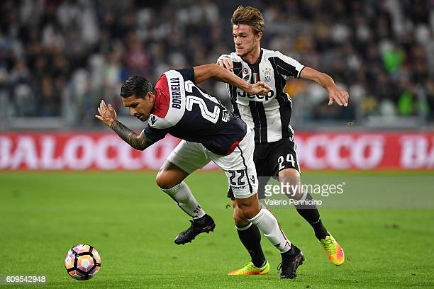 Daniele Rugani of Juventus FC tackles Marco Borriello of Cagliari Calcio during the Serie A match between Juventus FC and Cagliari Calcio at Juventus...