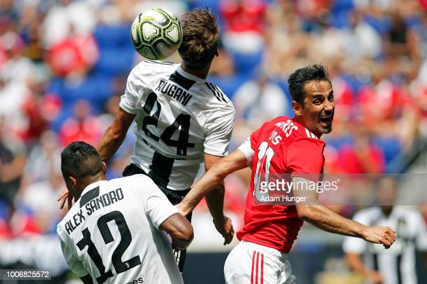 Daniele Rugani of Juventus heads the ball over Jonas of Benfica in front of Alex Sandro of Juventus during the International Champions Cup 2018 match...