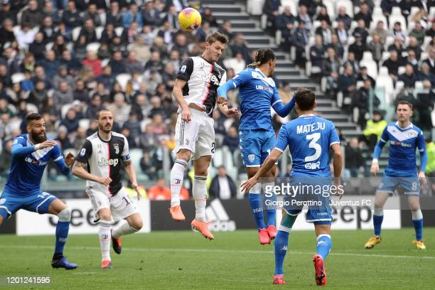 Daniele Rugani of Juventus jumps for the ball against Florian Aye of Brescia Calcio during the Serie A match between Juventus and Brescia Calcio at...