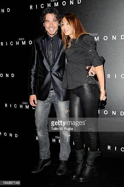 Daniele Santoianni and Flo attend the John Richmond Milan Fashion Week Womenswear S/S 2011 show on September 22 2010 in Milan Italy