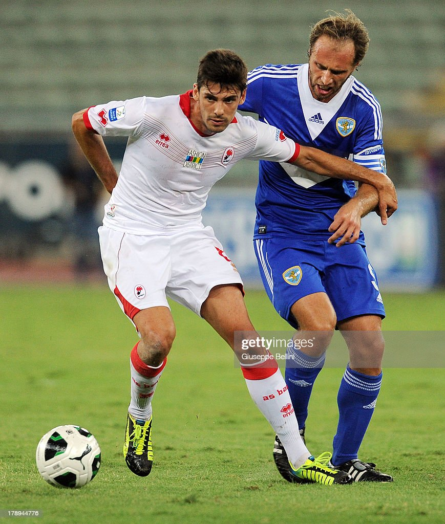 Daniele Sciaudone of Bari and Alessandro Budel of Brescia in action during the Serie B match between AS Bari and Brescia Calcio at Stadio San Nicola on August 31, 2013 in Bari, Italy.