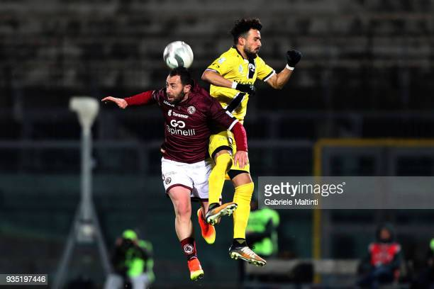 Daniele Vantaggiato of AS Livorno Calcio battles for the ball with Dennis Iapichino of AC Siena during the Serie C match between AS Livorno and AC...