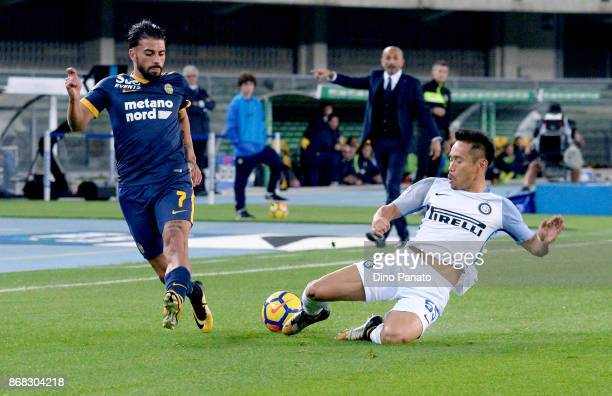 Daniele Verde of Hellas Verona FC competes with Yuto Nagatomo of FC Internazionale during the Serie A match between Hellas Verona FC and FC...