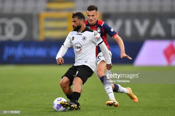 Daniele Verde of Spezia is put under pressure by Arkadiusz Reca of F.C. Crotone during the Serie A match between Spezia Calcio and FC Crotone at...