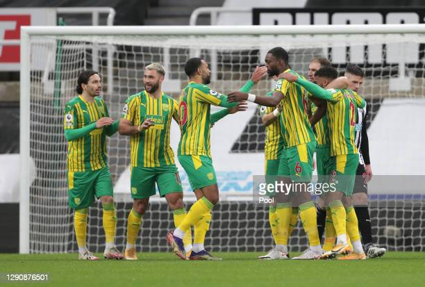 Daniell Furlong of West Bromwich Albion celebrates with teammates after scoring his team's first goal during the Premier League match between...