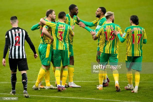 Daniell Furlong of West Bromwich Albion celebrates with teammates Branislav Ivanovic, Kieran Gibbs, Semi Ajayi, Matt Phillips, Charlie Austin, and...