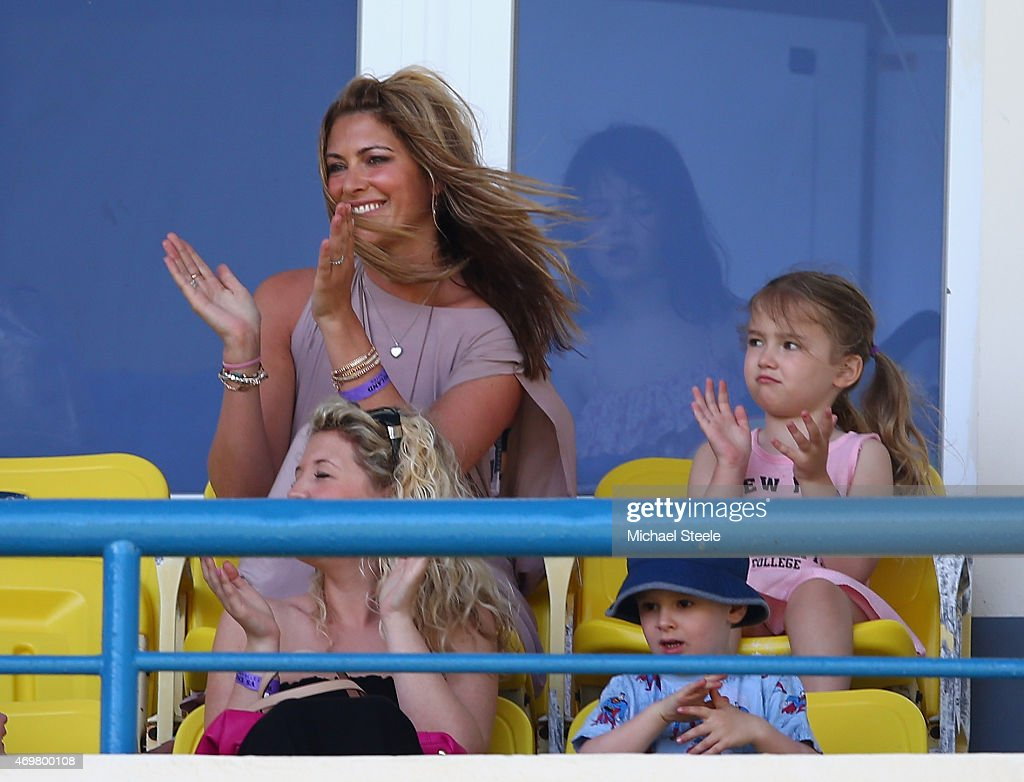 Daniella Anderson (L) the wife of England cricketer James Anderson looks on alongside daughter Ruby Luxe (R) ) during day three of the 1st Test match between West Indies and England at the Sir Vivian Richards Stadium on April 15, 2015 in Antigua, Antigua and Barbuda.