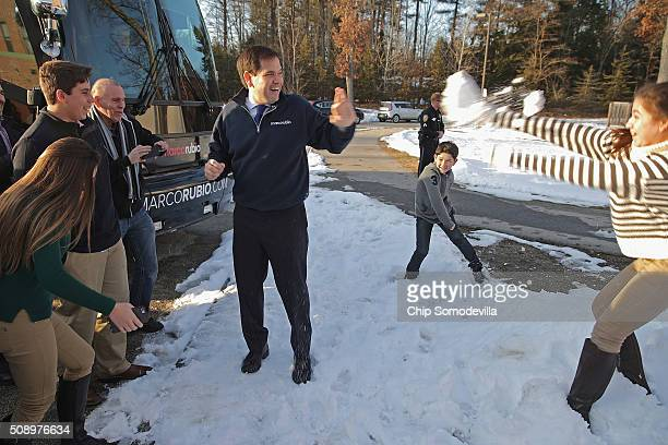 Daniella Rubio throws a snowball at her father Republican presidential candidate Sen Marco Rubio after a town hall meeting at Hills Garrison School...