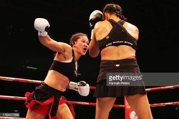 Daniella Smith of New Zealand fights Alene Blencowe of Australia for the WIBA Women's Light Welterweight World Title at Trusts Stadium on June 13...