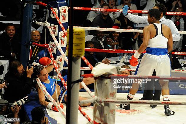 Daniella Smith of New Zealand is hit by Noni Tenge of South Africa during the IBF female welterweight bout at Carnival City on June 11 2011 in...