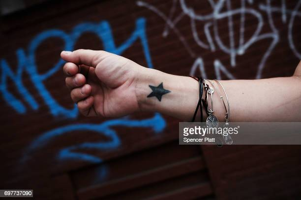 Danielle a patient at a Brooklyn methadone clinic for those addicted to heroin displays bracelets that help motivate her in the struggle with...