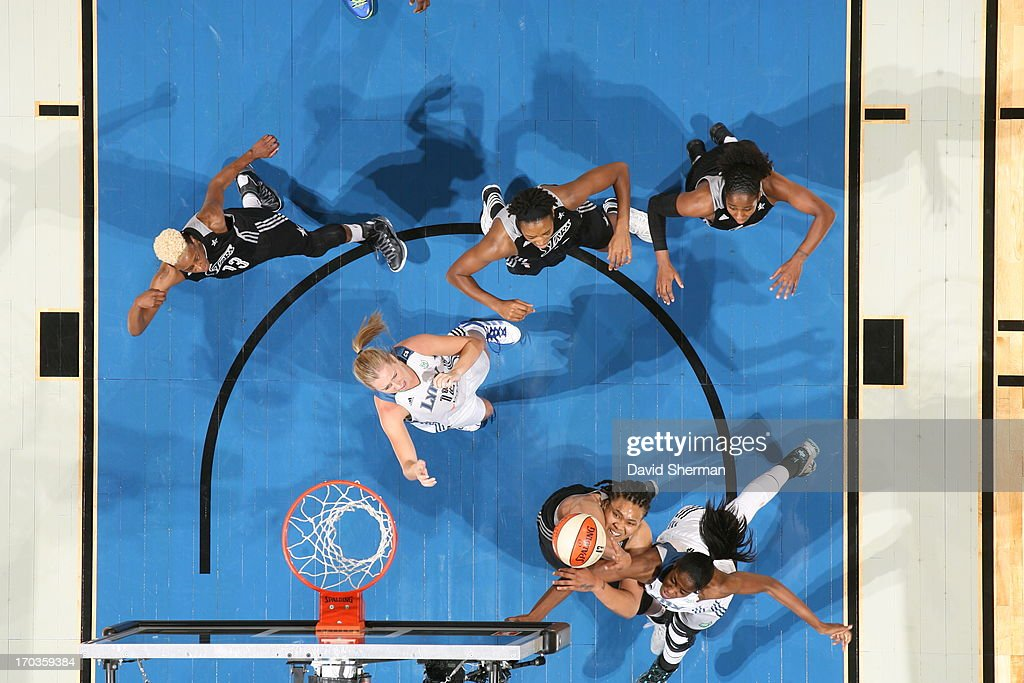 Danielle Adams #23 of the San Antonio Silver Stars attempts to rebound against Devereaux Peters #14 of the Minnesota Lynx during the WNBA game on June 11, 2013 at Target Center in Minneapolis, Minnesota.