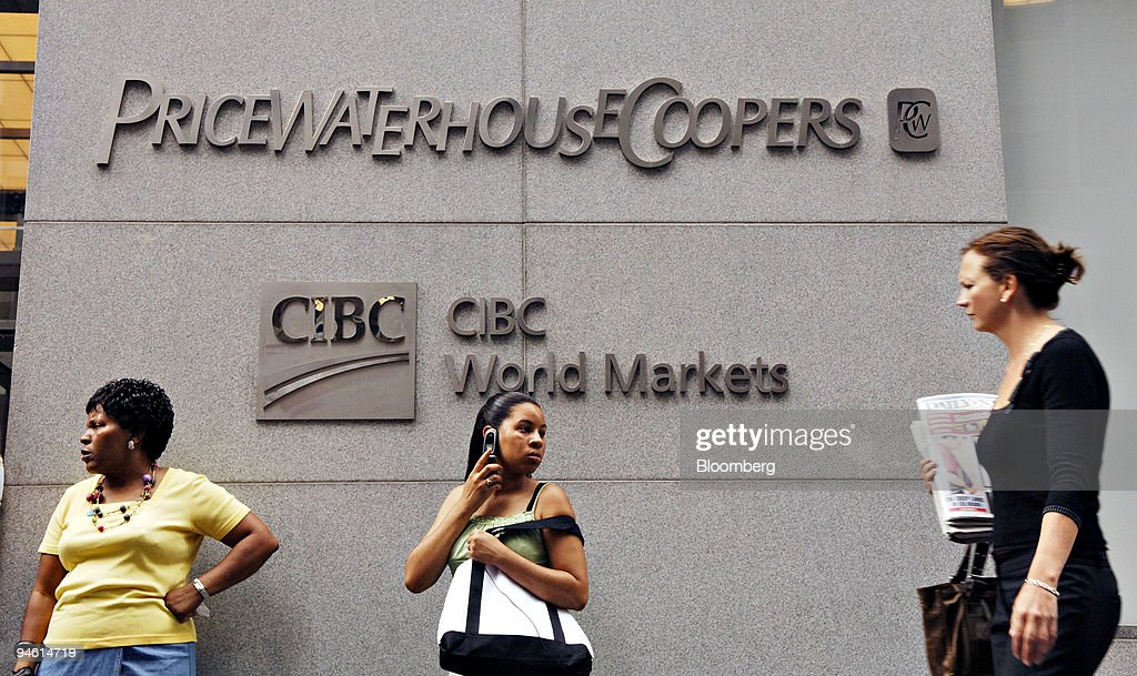 Danielle Alston of Union City, Tennessee, center, talks on her cell phone outside the PricewaterhouseCoopers offices at 300 Madison Avenue in New York, Friday, August 25, 2006. Her mom, Beverly Alston, stands at left. PricewaterhouseCoopers LLP, the world's largest accounting firm, is being audited by the Internal Revenue Service for potential violations in reporting its own taxes, according to IRS and company documents.