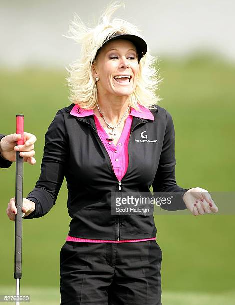 Danielle Amiee winner of the Golf Channel's Big Break III laughs as she walks off the tenth green during the first round of the Michelob Ultra Open...